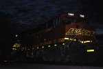 BNSF 7305 lead DPU and BNSF 6637 reflect the flash off their BNSF Swoosh reflective Logo as Dusk settles in behind them.